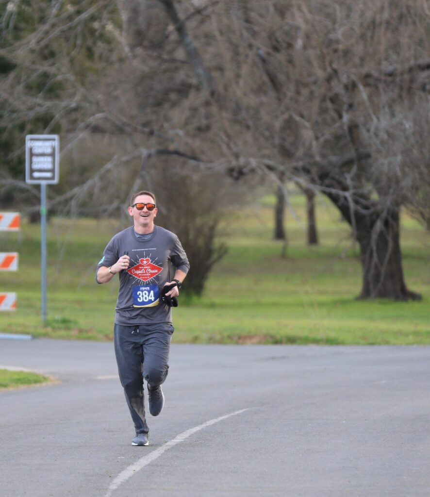 Man running while wearing a Cupid's Chase shirt